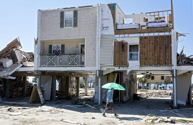 A home hit by Hurricane Michael stands in Mexico Beach Wednesday, October 17, 2018. (LANNIS WATERS / The Palm Beach Post)