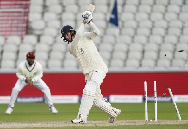 England's Zak Crawley is bowled out by West Indies' Kemar Roach during the fourth day of the second cricket Test match between England and West Indies at Old Trafford in Manchester, England, in 2020.