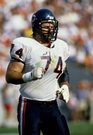 Tackle Jimbo Covert (74) runs on the field in this Nov. 20, 1988, file photo of the Chicago Bears-Tampa Bay Buccaneers game at Tampa Stadium.