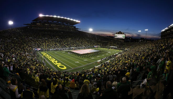 Fans fill Autzen Stadium at night in 2019. University of Oregon students will have a different option for getting tickets for sporting events next school year.