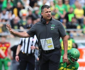 Oregon Ducks coach Mario Cristobal will have to manage a larger roster if the NCAA allows players an extra year of eligibility. [Chris Pietsch/The Register-Guard] - registerguard.com