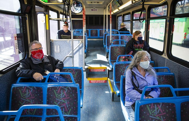 Passengers wear masks as ride an Lane Transit District bus from downtown Eugene to the River Road area.