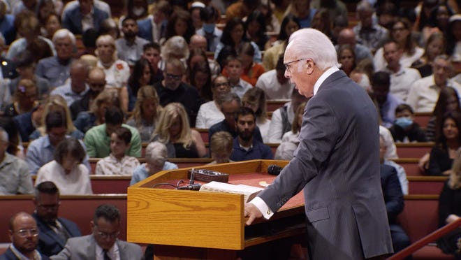The Rev. John MacArthur speaks at Grace Community Church in Sun Valley, California, on July 26. The church has been holding services attended by throngs of worshippers in defiance of state and county limits on indoor gatherings.