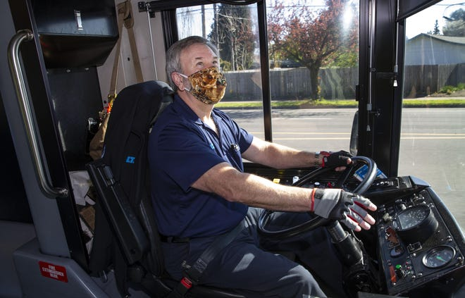 Lane Transit Department driver Mark Walker keeps an eye on his riders during his route through Eugene.