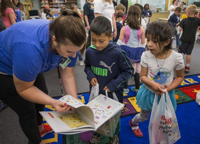 The United Way used PPP loans to provide basic services to the community and collaborated with area nonprofits to give aid and secure their own PPP loans. Elizabeth Gray, left, helps students pick a book during 2018 BookFest at Guy Lee Elementary School in Springfield. The book giveaway is a collaboration of United Way of Lane County, the Early Learning Alliance and Connected Lane County.