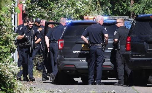 Officers swarmed an alley between 10th and 12th streets just north of Main Street shortly after 4:30 p.m., reportedly responding to an armed suspect in a car.