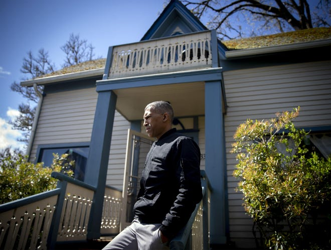 Eugene/Springfield NAACP President Eric Richardson in front of the historic Mim's House.