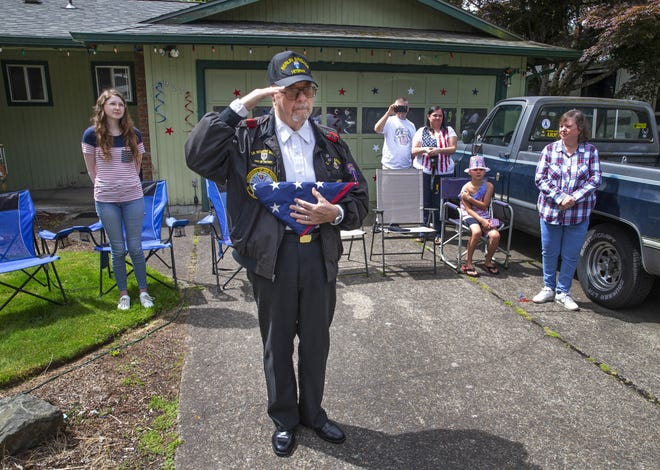 Joined by four generations of his family, veteran Ken Splinter salutes members of the Tribute to Fallen Soldiers Northwest during a ceremony to honor him in front of his home in Springfield. [Chris Pietsch/The Register-Guard] - registerguard.com