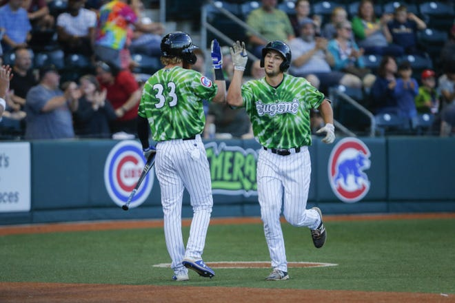 Eugene's Chase Strumpf celebrates his home run with Grayson Byrd (33) during a 2019 game against the Hillsboro Hops at PK Park.
