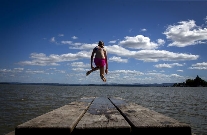 Madilyn Stockinger leaps into Fern Ridge Reservoir while visiting Richardson Park. The lake is a popular destination for those seeking a place to cool off.