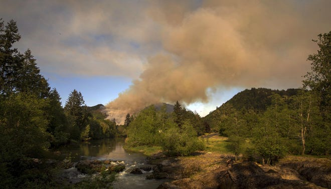 Helicopters and firefighters work to control a blaze near the Dorena Grange near Cottage Grove on May 10, 2019.  [File/Andy Nelson/The Register-Guard] - registerguard.com