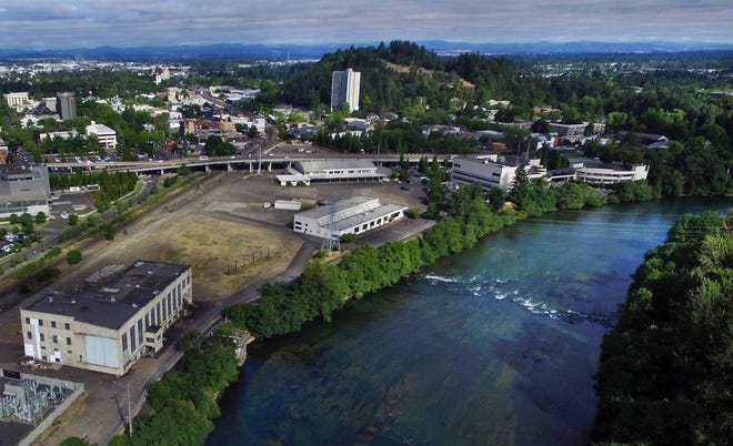 Eugene's downtown riverfront, shown here looking northwest toward the EWEB site, with the Willamette River at right before demolition and construction began in 2018.