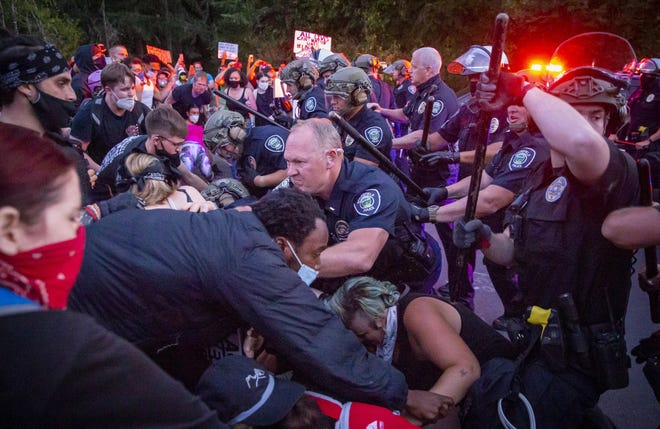 Springfield police grapple with protesters July 29, 2020 at a barricade in the Springfield, Oregon, Thurston neighborhood protest.