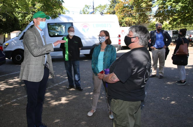 CAHOOTS crisis worker Theresa Boudreau, right, visits with U.S Sen. Ron Wyden and Eugene Mayor Lucy Vinis during a visit to Eugene in July 2020.