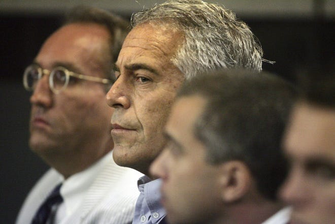 Jeffrey Epstein, center, appears in court in Palm Beach County Circuit Court in 2008.