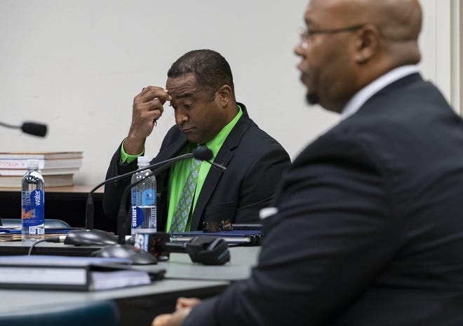 Fired Spanish River High Principal William Latson listens Tuesday as Dr. Donald E. Fennoy II, superintendent of the Palm Beach County School District, testifies during an administrative court hearing in which Latson is try to get his job back.