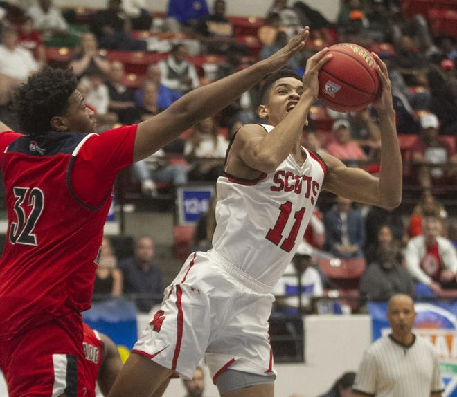 In the 2019 Class 3A state semifinals, St. Andrew's Josh Minott shoots while Chaminade-Madonna's Javaris Rolle defends. Minott, a Memphis signee, and St. Andrew's are aiming for a second consecutive state title this season.