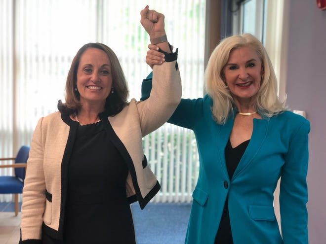 Palm Beach County Clerk and Comptroller Sharon Bock, right, lifts the arm of top executive Shannon Chessman in triumph on March 4 as Bock announces her retirement and support for Chessman to take her place, a vision that unraveled by June.