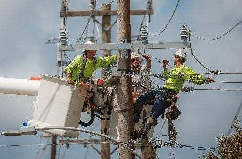 Lake Worth Electric Utility workers.