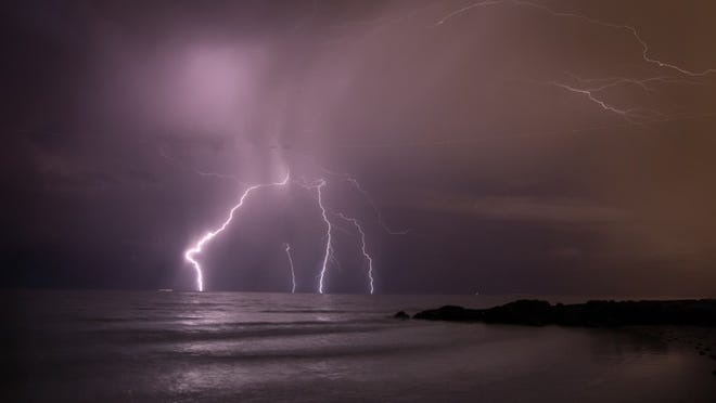 Lightning strikes over the ocean off Midtown Beach in Palm Beach, July 28, 2017.