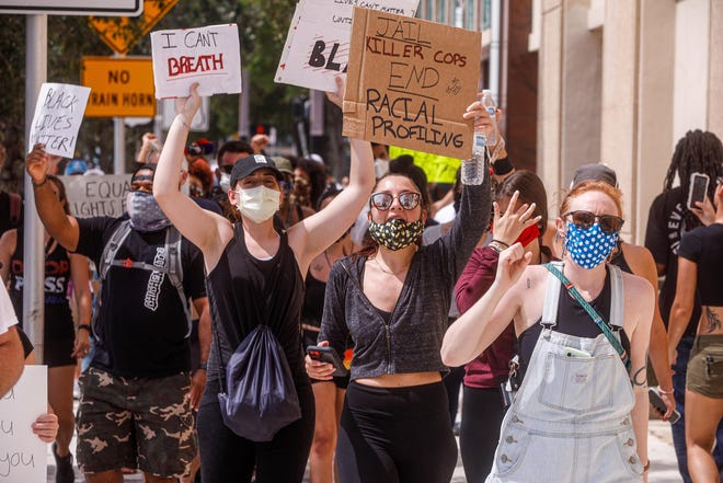 WEST PALM BEACH -- A group of mostly young adults take part in a George Floyd protest that began at West Palm Beach City Hall and then weaved its way around the downtown area for several hours on June 2.