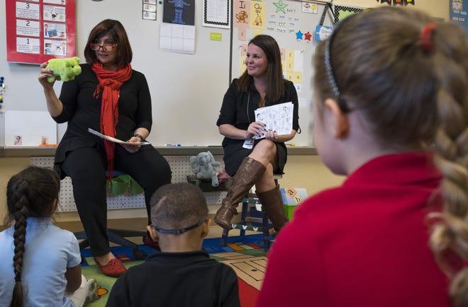 JulieAnn Rico, the Palm Beach County School Board's general counsel, reads alongside kindergarten teacher Lesli Troy during class at Plumosa School of the Arts in Delray Beach in 2017.