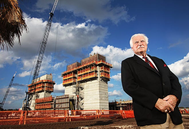 Then Florida Atlantic University football coach Howard Schnellenberger stands in front of the team's new stadium, which was under construction and is now named for him, in 2011. His building of the Owls football program as well as success at Miami and Louisville have earned him the Paul 'Bear' Bryant Lifetime Achievement Award.