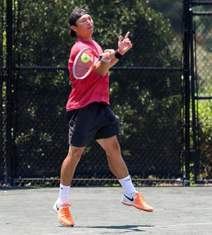 Rob Dunn hits a forehand shot during the 4.5 doubles final of the Pritchett-Moore Men's City Invitational hosted at Indian Hills Country Club, which concluded play on Sunday. Dunn and his partner Mark Hearing defeated Kyle Cavender and Joel Wester 6-2, 6-4.