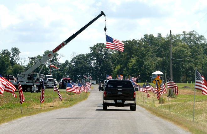 Flags line the entry to the Veterans Appreciation Day on Aug. 3, 2019, at the Ashland County Airport. This year's event will be held Saturday.