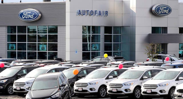 In this Thursday, Aug. 15, 2019 file photo, cars are for sale at a Ford dealership in Manchester, N.H. New vehicle sales in the U.S. fell slightly last year, but the numbers still passed the healthy 17 million mark for the fifth straight year. Automakers sold 17.1 million new cars, trucks and SUVs in 2019, down about 1% from the previous year.