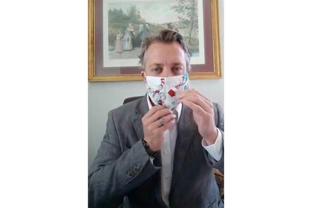Maury County Mayor Andy Ogles demonstrates the use of a face mask during a live community update on Monday, April 6, 2020.