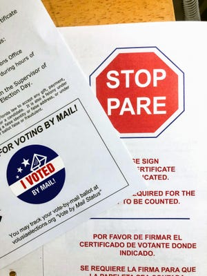 "Vote-by-mail instructions with an ""I voted"" sticker included in the kit."