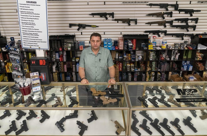 Alex Shkop says business has surged at Guns and Range Training Center in West Palm Beach since the coronavirus began spreading.