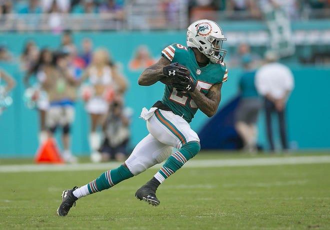 Miami Dolphins cornerback Xavien Howard returns an interception during a game againt the Buffalo Bills.