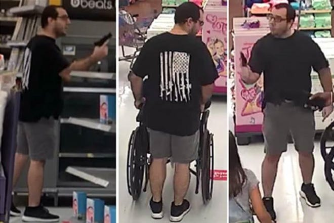 Vincent Scavetta is seen in Walmart surveillance footage from July 12, when he was involved in an argument over face masks that led to Scavetta's arrest for aggravated assault with a firearm and improper exhibition of a firearm.