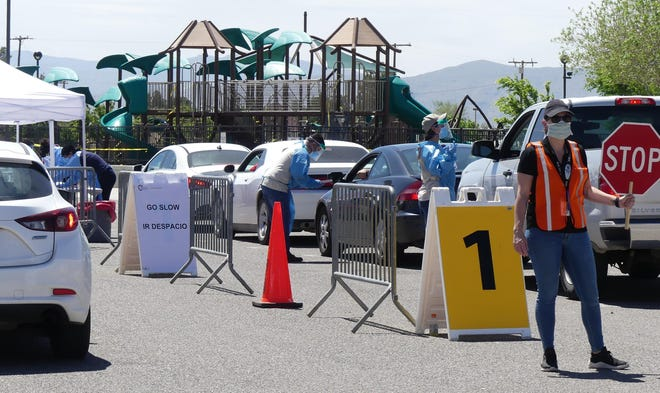 Hundreds of San Bernardino County residents waited in vehicles to be tested for COVID-19 on April 30, 2020, at Civic Center Park in Apple Valley.