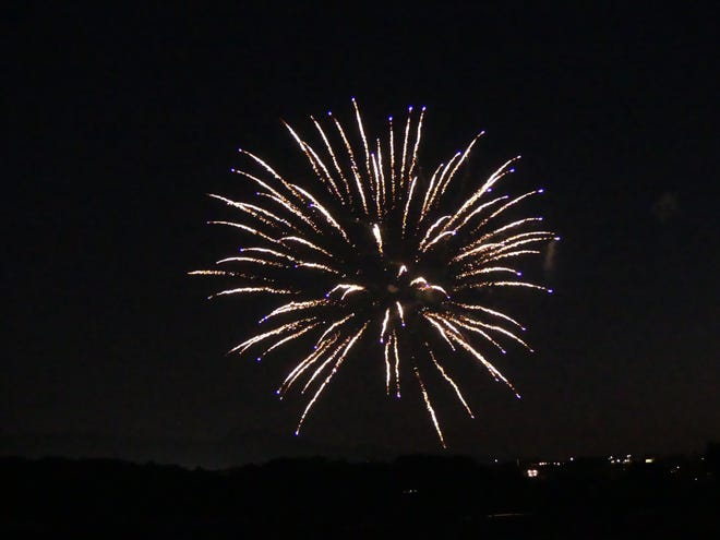 A firework explodes in a night sky in the High Desert.
