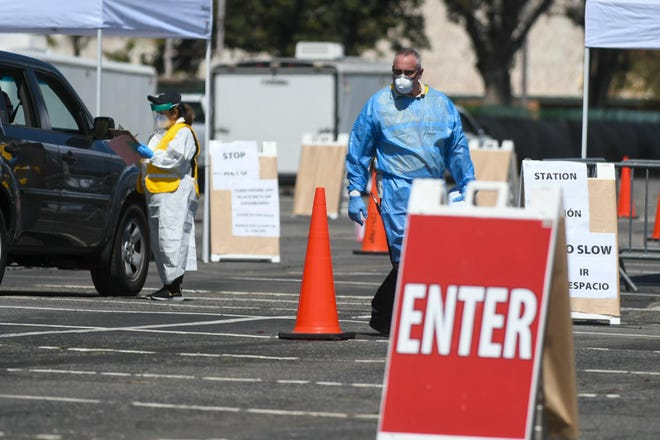 Health officials at a COVID-19 testing site in San Bernardino County.