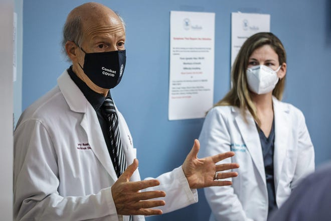 An AstraZeneca COVID-19 vaccine trial on the campus of JFK Medical Center in Atlantis, Fla. Dr. Larry Bush and nurse practitioner Elizabeth Sheldon talk to the press on Monday, August 17, 2020.
