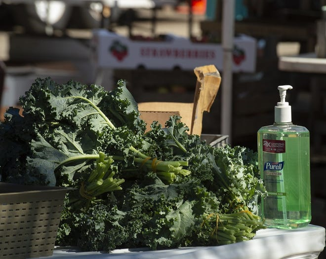 The outdoor Haymaker Farmers' Market takes place every Saturday from 9 a.m. to 1 p.m. on Franklin Avenue under the Haymaker overpass. Pictured, a bottle of hand sanitizer sits next to some produce on a vendor table on June 20, 2020.