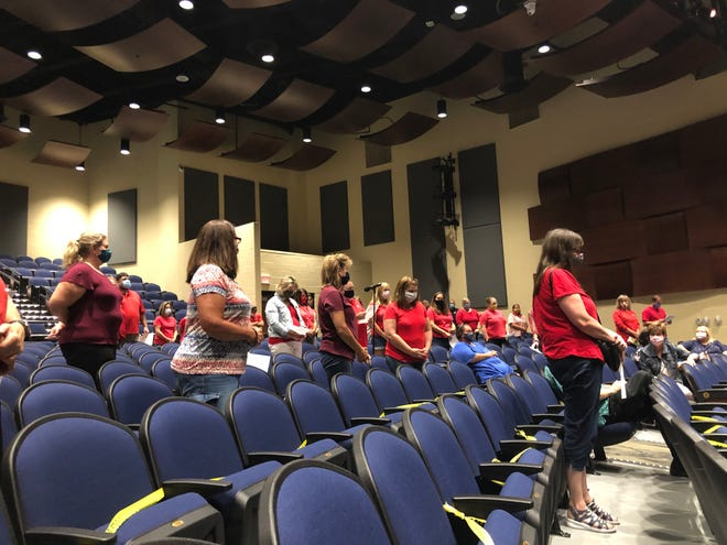 Over 70 Streetsboro teachers and staff members stand in solidarity during an August school board meeting as Streetsboro Education Association President John Oleksa urges the Board of Education to implement a fully digital learning model for at least the first grading period.