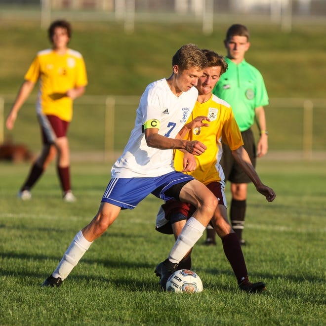 Ravenna junior Zack Myers drives for a goal during the first half against Southeast.