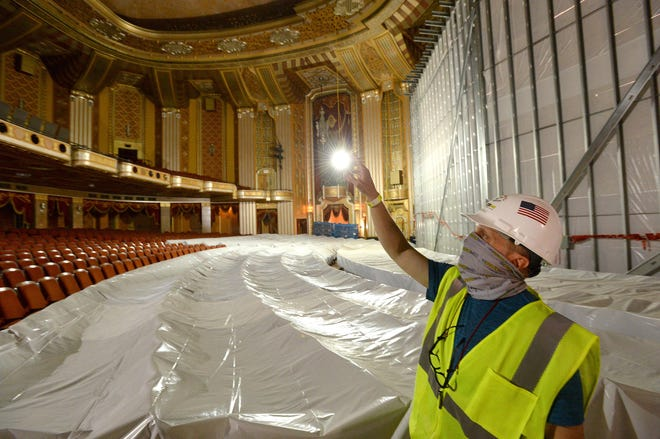 Barry Copple, operations manager at the Warner Theatre, shows some of the renovations taking place. The renovations will create 13,750 square feet of new space; rehabilitate 9,000 square feet of existing space; and increase the stage depth by 20 feet. The work will also add new rigging, an updated sound system, new loading docks, additional production equipment and a customized orchestral shell.