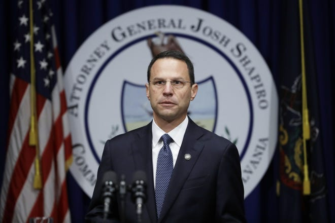 Pennsylvania Attorney General Josh Shapiro speaks during a news conference at the Capitol in Harrisburg on Aug. 14, 2018.