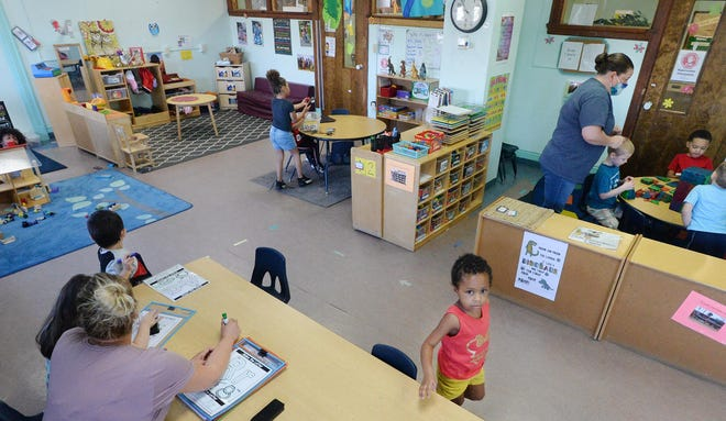 At the Downtown YMCA, teachers and students, including Elliawna Sanchez, 3, lower right, stay busy at different stations in a preschool classroom on Tuesday. The YMCA of Greater Erie is celebrating its 160th anniversary, with childcare and education a major focus throughout its history.
