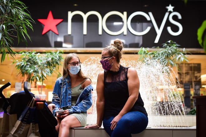 Utica resident Vanessa Stacks sits near the fountain in front of Macy's with her daughters Alyssa and Aubrey in August at Sangertown Square. The store is set to close in April.