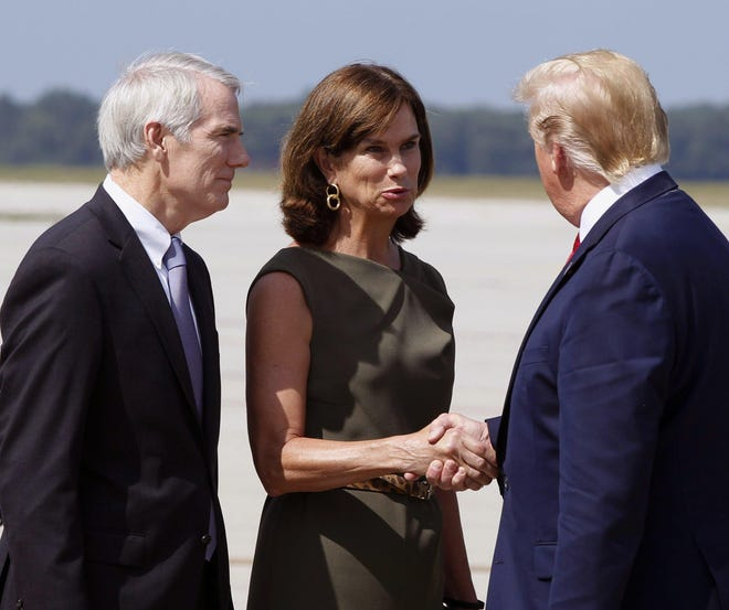U.S. Senator Rob Portman (R) and his wife Jane are greeted by President Donald Trump at Wright-Patterson Air Force Base, Wednesday, Aug. 7, 2019, in Dayton, Ohio. Trump is in Dayton to visit with families of victims of the mass shooting that took place here on Sunday.