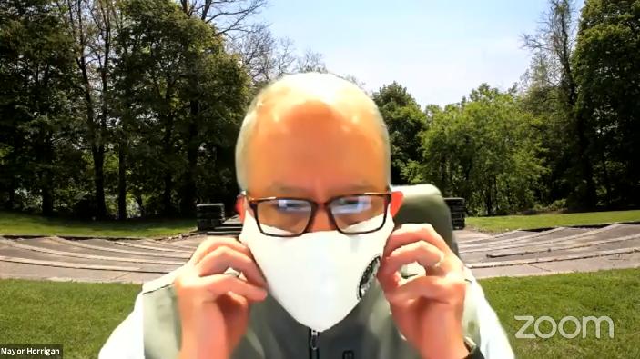 Akron Mayor Dan Horrigan dons his mask in 2020 during a weekly series of virtual town hall meetings.