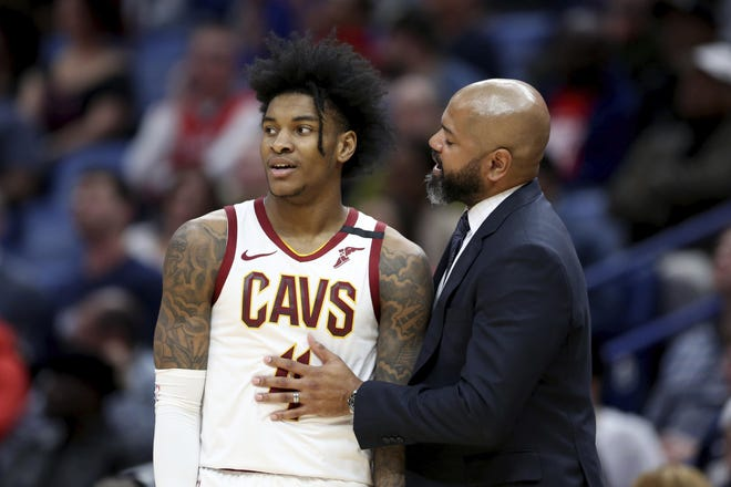 Cavaliers coach J.B. Bickerstaff talks to guard Kevin Porter Jr. during a timeout in a game in February. [Rusty Costanza/Associated Press]
