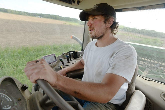 Dairy farmer Steven Woods plants soybeans Wednesday at his farm in Washington Township. Woods, 32, is used to price fluctuations. The price for 100 pounds of milk, which had topped $20 earlier this year, fell at one point to about $11.